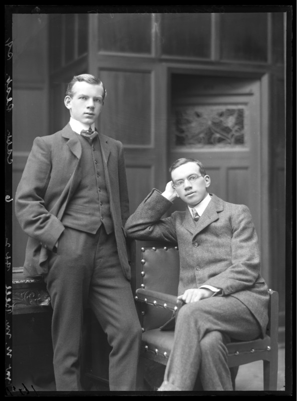 Mr N M Bell, two young men ca 1909